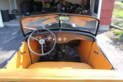 American Austin Roadster for sale: interior upholstery, gauges, windshield, dashboard, steering wheel.