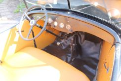 American Austin Roadster closeup of dashboard transmission shifter, gauges, floor mat